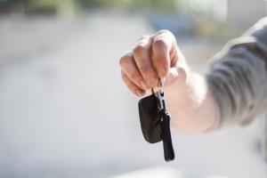 Individual handing over car keys.